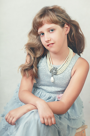 beautiful eight years girl contemporary portrait Фото со стока