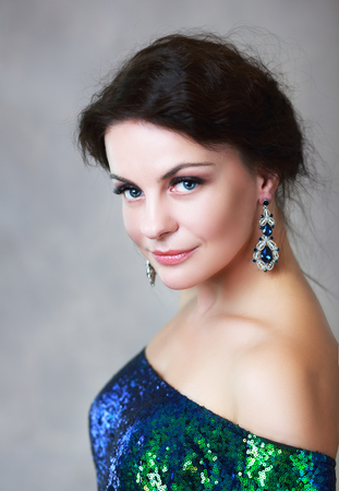 beautiful mature woman beauty portrait blue earrings Stock fotó
