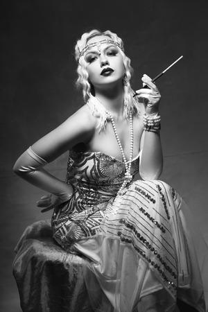 beautiful woman retro flapper style smoking outdoors Stock fotó