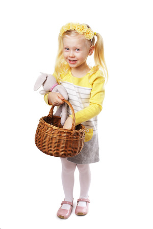 Child holding and easter egg with easter basket on white background Stock fotó