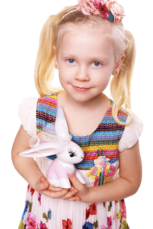 little blond girl hold rabbit toy isolated