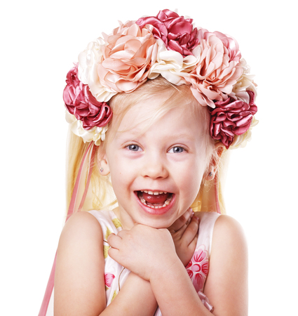 happy laughing suprised little blond girl in flower crown Фото со стока