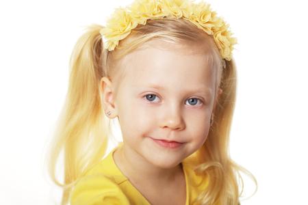 beautiful blond girl in yellow flower crown 4 years old Stock fotó