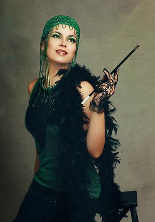 Beautiful woman retro flapper style woman wearing cloche, roaring 20s