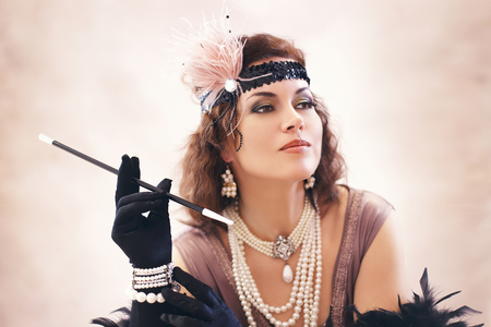 Beautiful woman retro flapper style woman , roaring 20s