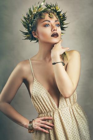 Beautiful woman as greece goddess, golden wreath on her head, painterly look image