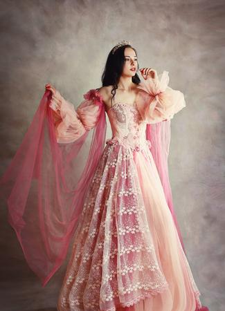 beautiful brunette princess peach pink dress painterly look old fashion Stock fotó