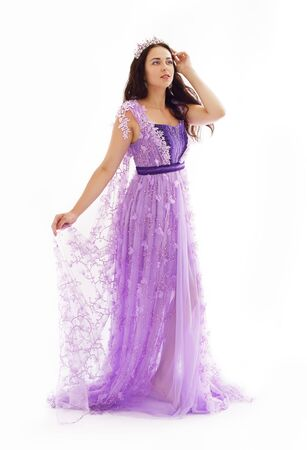 Beautiful woman in violet dress and crown, lace gown Stock fotó