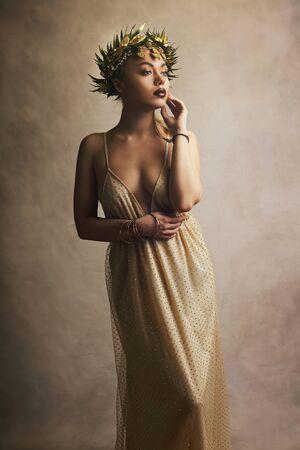 Beautiful woman in Greek  goddess dress and wreath high fashion