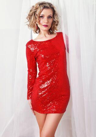 Cute woman in gorgeous dress long sleeves