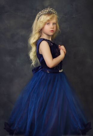 Style little girl in blue gown portrait  look couture kid