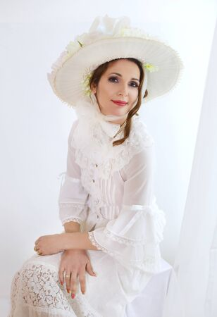 Beautiful female in Victorian  age hat and  dress