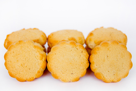 shortcake: shortcake in the form of a camomile of yellow color on a white background isolate Stock Photo