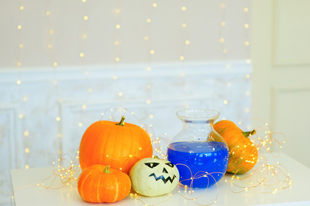 brebaje: Table with Halloween pumpkins and bottle of potion