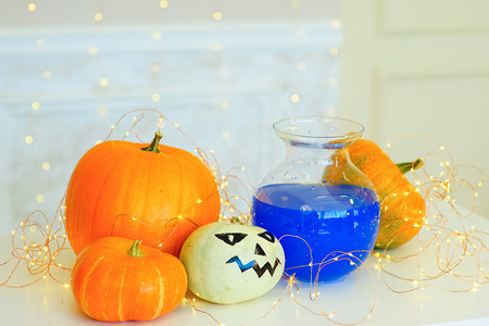 pocion: Table with Halloween pumpkins and bottle of potion