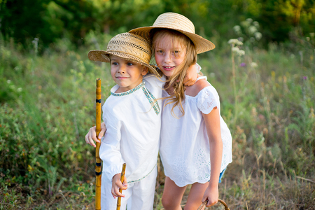 brother and sister on walk, warm summer vacations close up