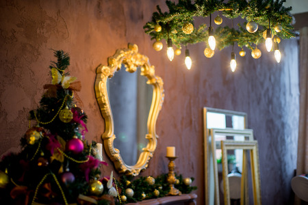Christmas tree, mirror, chandelier. Christmas interior in purple and gold colors Фото со стока