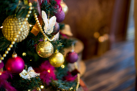 chandelier: Christmas tree, mirror, chandelier. Christmas interior in purple and gold colors Stock Photo