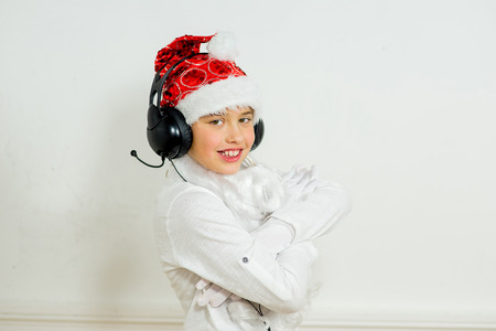 rudeness: boy pretending he is a Bad Santa with chains, headphones Stock Photo