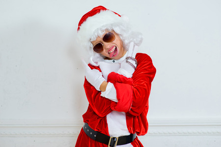 boy pretending he is a Bad Santa with chains, headphones and sunglasses