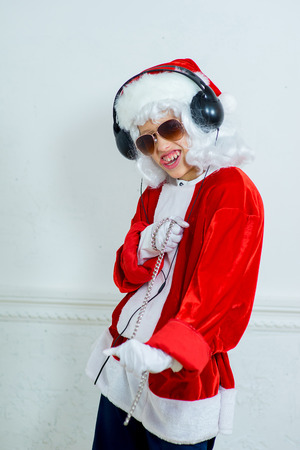 rudeness: boy pretending he is a Bad Santa with chains, headphones and sunglasses