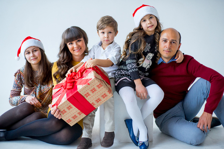 Christmas family of five people, happy parents and their kids with gifts. isolated