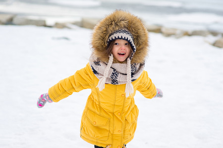 Portrait of young girl who walks outdoors on the frozen lake