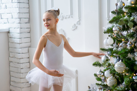 Young ballet dancers learning the lesson near the wall. Try some new pose