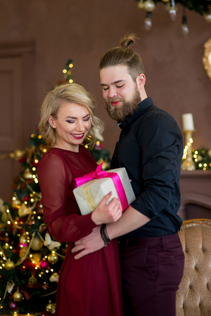 Happy couple of lovers give each other gifts Stock Photo