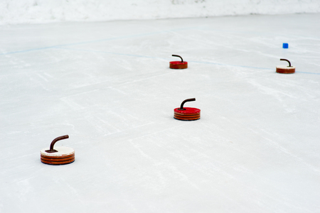 curling: Curling stones on the ice