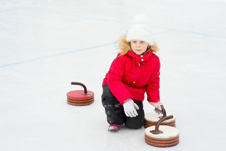 Young girl playing curling