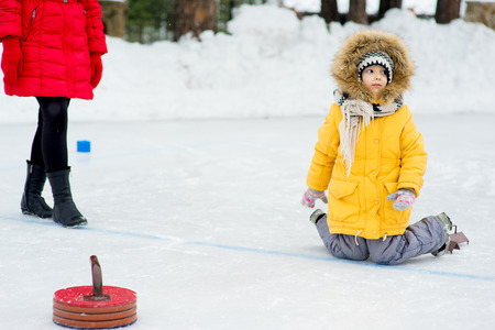 Young girls playing curling