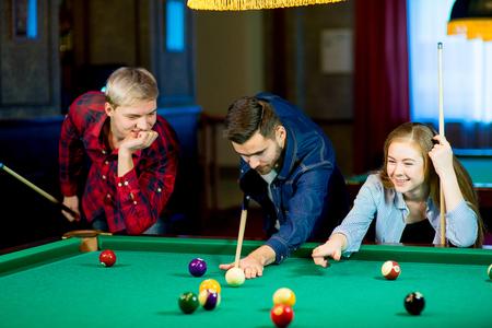 friends playing billiard