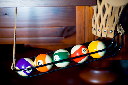 Billiard balls in the pocket Stock Photo