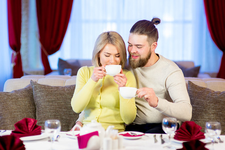 loving young couple drinking tea in the restaurant