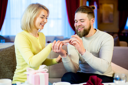 young man gives engagement ring Stock Photo