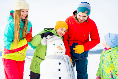 Family making a snowman Stock Photo