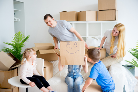 first time buyer: Family unpacking boxes