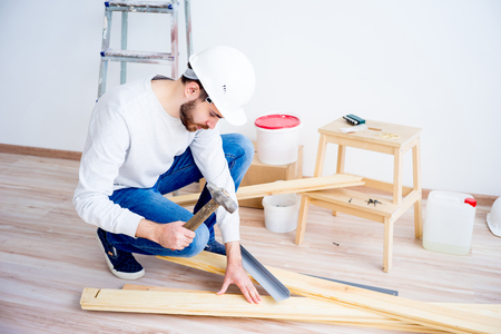 Man hammering nails
