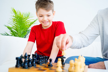 chess board: Father and son playing chess