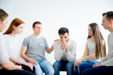 round chairs: Group therapy in session Stock Photo