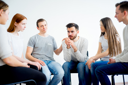 Group therapy in session Stock Photo