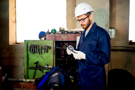 toolroom: Worker with lathe Stock Photo