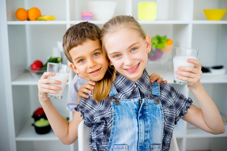 Children drink milk Stock Photo