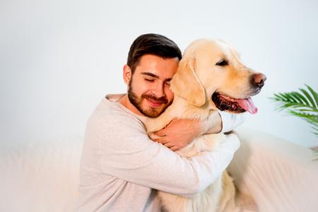 Man playing with his dog Standard-Bild