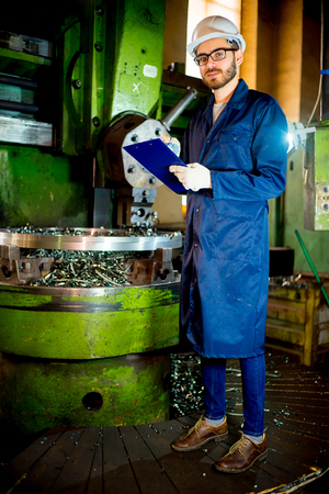 Worker with lathe Stock Photo