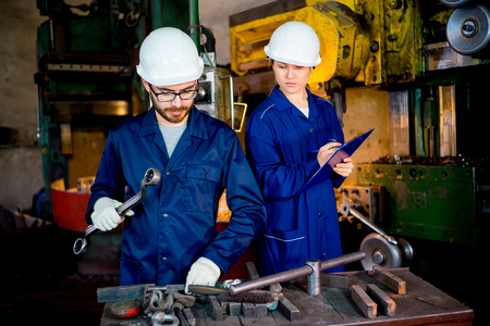 toolroom: Workers with lathe Stock Photo