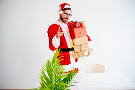 Handsome Santa Claus giving presents