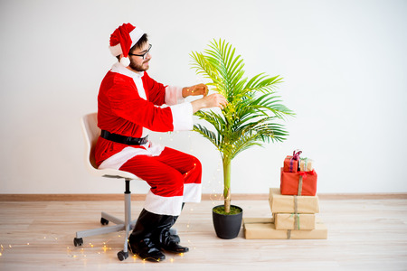 decorating: Santa decorating a tree Stock Photo