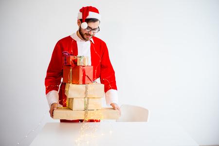 saint nicolas: Handsome Santa Claus giving presents